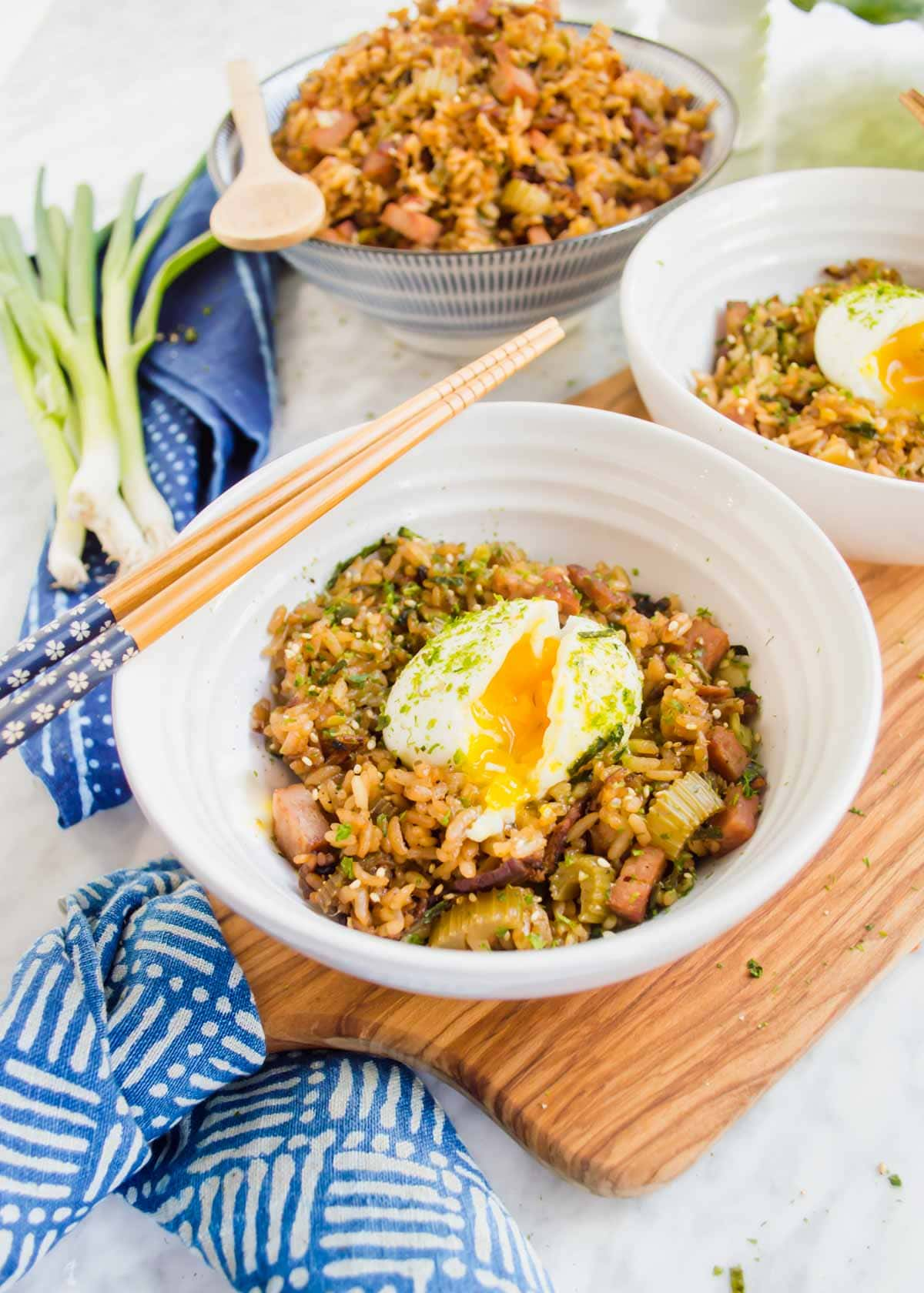 Shoyu Breakfast Fried Rice in bowls with soft boiled eggs.