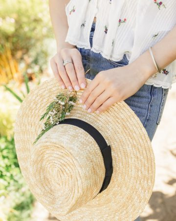 straw hat in hand sun protection